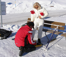 Arosa, Switzerland - Ernesto helping Debra with Snowshoes