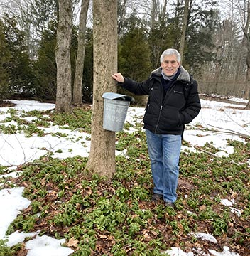 Edward F. Nesta with maple sap bucketi - Stamford Museum & Nature Center - photo by Luxury Experience