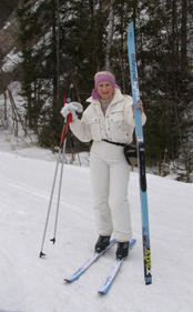 Cross-country skis - Debra Showing length of Cross-country Skis - Photo by Luxury Experience
