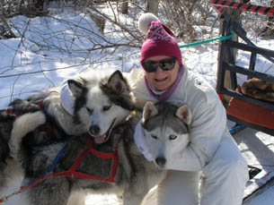 Debra with the Sled Dogs - Sled Dog - Expedition Wolf, Quebec, Canada - Photo by Luxury Experience - Smith Optics Sunglasses