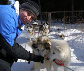 Edward rewarding the dogs with a treat - Sled Dog - Expedition Wolf, Quebec, Canada - Photo by Luxury Experience