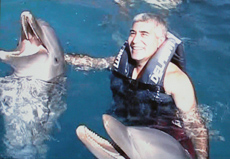 Edward F. Nesta with Dolphins at Delfiniti in Ixtapa,Zihuantanejo, Mexico