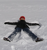 Jungfraujoch, Switzerland - Debra C. Argen making snow angels