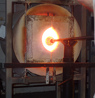 Molten glass to glory hole to start shaping process at The Hotspot Glass Studio, Fairfield, CT - photo by Luxury Experience