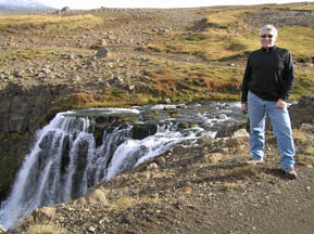 Edward by Waterfall in Iceland - Photo by Luxury Experience