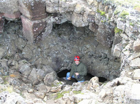 Edward climbing out of Lava Cave in Iceland- Photo by Luxury Experience