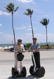 Debra and Edward riding Segways on Beach with  M Cruz Rentals, Fort Lauderdale, Florida
