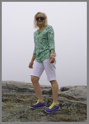 Debra Argen treking along the Maine Coastline at Prouts Neck, Maine - photo by Luxury Experience