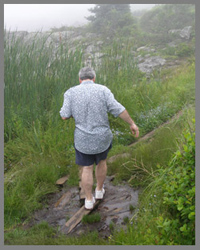 Edward Nesta treking the Maine Coastline in Prouts Neck, Maine - photo by Luxury Experience