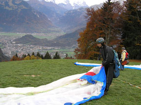 Pietschly and Nicole Preparing the Paraglider  - photo by Luxury Experience