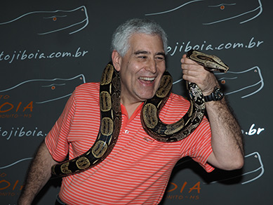 Edward F. Nesta with Boa Constrictor - Projeto Jiboia - photo by Luxury Experience