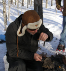 Yves Kirouac showing how to start a fire in the woods while snowshoeing in Mont-Tremblant - Photo by Luxury Experience