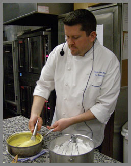 Chef Laurie Jon Moran - folding passion fruit mixture - photo by Luxury Experience