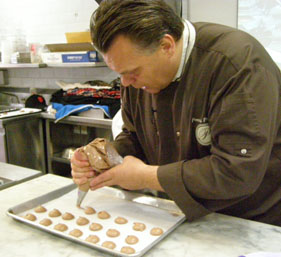 Chef Piping Macarons - New York Culinary Experience - Photo by Luxury Experience