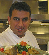 Chef Eyup with Grilled Fillet of Sea Bass