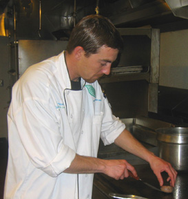 Cooking Lamb Sausage - Chef Chad Shrewsbury of SIx Peaks Grille - Resort at Squaw Creek - Photo by Marc Sapoznik of Resort at Squaw Creek
