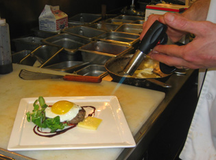 Toasting Fontina Cheese - Chef Chad Shrewsbury of SIx Peaks Grille - Resort at Squaw Creek - Photo by Marc Sapoznik of Resort at Squaw Creek