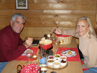Edward and Debra share fondue at Pr�tschli-Stall, Arosa, Switzerland