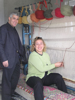 Tommy Goskin and Edward F Nesta weaving a carpet