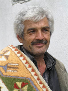 Turkish man with finished carpet