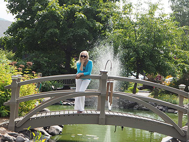Debra C. Argen enjoying the grounds - Emerson Resort & Spa - Mt. Tremper, NY - photo by Luxury Experience