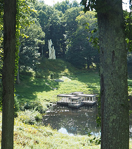 Tower Statue and Pavilion in the pond - - photo by Luxury Experience