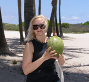 Debra C. Argen sipping fresh coconut water