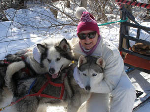 Debra with sled dogs Harricana and Malouk - photo by Luxury Experience