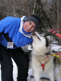 Edward with sled dog Malouk - photo by Luxury Experience
