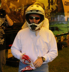 Donning Helmet and Gloves to race - Edward F Nesta - Photo by Luxury Experience