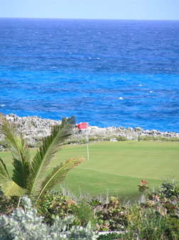 Golf green with water view at The Abaco Club on Winding Bay