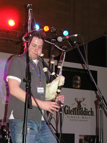 Finlay MacDonald wailing on the bagpipes