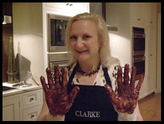 Debra Argen with chocolate covered gloves  - Photo by Luxury Experience