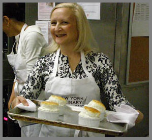 Debra C. Argen with finished souffle  - NY Culinary Experience 2013 - photo by Luxury Experience