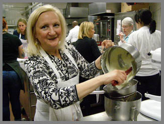 Debra working with batter - Photo by Luxury Experience