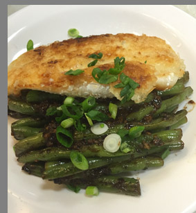 Fried Bronzino and Green Beans plate - photo by Luxury Experience