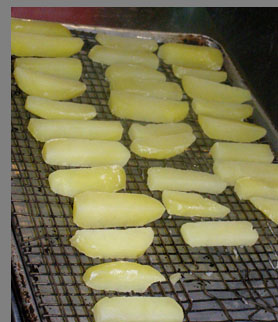 Potato chips ready to be deep fried - Chef Paul Liebrandt - New York Culinary Experience - photo by Luxury Experience