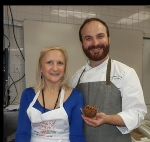 Chef miroslav Uskokovic and Debra C. Argen with pudding = Photo by Luxury Experience