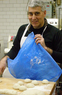 Covering dough to allow proofing  - New York Culinary Experience - Photo by Luxury Experience