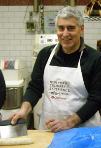 Edward Nesta using bread scrapper - New York Culinary Experience - Photo by Luxury Experience
