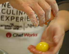 Sifting Egg through Hands at New York Culinary Experience, The International Culinary Center - Photo by Luxury Experience