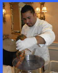 Chef Gese  cooking lobsters - photo by Luxury Experience