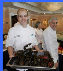 Chef John with live lobsters - photo by Luxury Experience