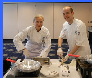 Debra Argen and Chef John shucking oysters  - photo by Luxury Experience