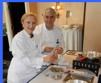 Debra Argen and Edward Nesta shucking clams  - photo by Luxury Experience