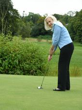 Dromoland Castle Hotel & Country Estate, Newmarket-on-Fergus, County Clare, Ireland - Debra C. Argen Practicing Her Putting