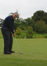 Dromoland Castle Hotel & Country Estate, Newmarket-on-Fergus, County Clare, Ireland - Edward F. Nesta Practicing His Putting