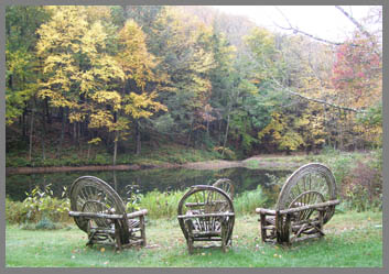 Chairs by lake - The Menla Mountain Retreat and Mahasukha Spa - Photo by Luxury Experience