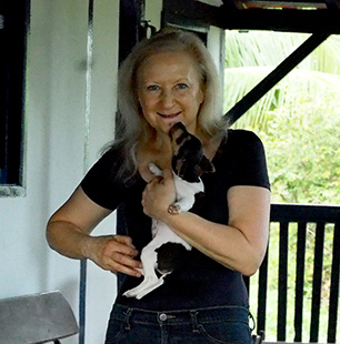 Debra C. Argen and puppy - Pousada Pequi - Aquidauana, Mato Grosso, do Sul, Brazil - photo by Luxury Experience