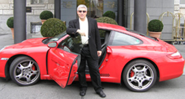 Edward F. Nesta and red Porsche 911 Carrera S